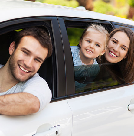 Family Looking Out Car Windows with Auto Insurance in Paso Robles, CA